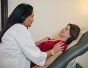Dr. Gloria Dunkin Working with a Patient